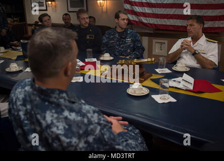 180313-N-OI558-1144 DOHA, Qatar (March 13, 2018) Vice Adm. Chris C. Aquilino, commander, U.S. Naval Forces Central Command, speaks during a meeting in the wardroom during his visit aboard the Arleigh Burke-class guided-missile destroyer USS Sampson (DDG 102). Sampson is deployed with the Theodore Roosevelt Carrier Strike Group to the U.S. 5th Fleet area of operations in support of maritime operations to reassure allies and partners and preserve the freedom of navigation and the free flow of commerce in the region. (U.S. Navy photo by Mass Communication Specialist 3rd Class Chanel L. Turner/Rel - Stock Photo