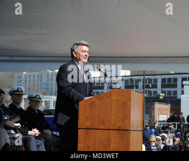 GROTON, Conn. (Mar. 17, 2018) The Honorable Cory S. Gardner, United States Senator, offers remarks at the commissioning ceremony for USS Colorado (SSN 788) on March 17, 2018. Colorado is the the U.S. Navy's 15th Virginia-class attack submarine and the fourth US Navy ship named for the State of Colorado.  (U.S. Navy photo by Chief Petty Officer Darryl I. Wood/Released) - Stock Photo