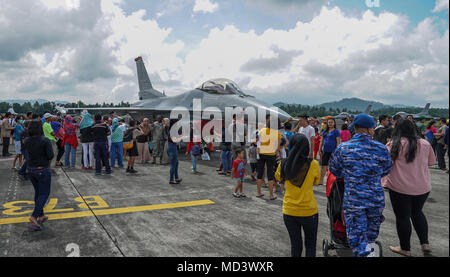 U.S. Air Force and Indonesian air force Airmen host an open house for the community during exercise Cope West 18 (CW18) at Sam Ratulangi International Airport, Indonesia, March 17, 2018. On display to the public was an U.S. Air Force F-16C Fighting Falcon aircraft assigned to the 13th Expeditionary Fighter Squadron, 35th Fighter Wing based out of Misawa Air Base, Japan. The Indonesian air force also displayed their F-16C, a H-225M Cougar helicopter and a CN-295 military transport aircraft. CW18 is a Pacific Air Forces-sponsored, bilateral exercise involving the U.S. and Indonesian air forces a - Stock Photo