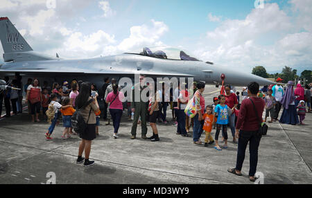 U.S. Air Force and Indonesian air force Airmen host and open house for the community during exercise Cope West 18 (CW18) at Sam Ratulangi International Airport, Indonesia, March 17, 2018. On display to the public was an U.S. Air Force F-16C Fighting Falcon aircraft assigned to the 13th Expeditionary Fighter Squadron, 35th Fighter Wing based out of Misawa Air Base, Japan. The Indonesian air force also displayed their F-16C, a H-225M Cougar helicopter and a CN-295 military transport aircraft. CW18 is a Pacific Air Forces-sponsored, bilateral exercise involving the U.S. and Indonesian air forces  - Stock Photo