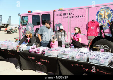 Members of the Pink Heals Tour display merchandise during