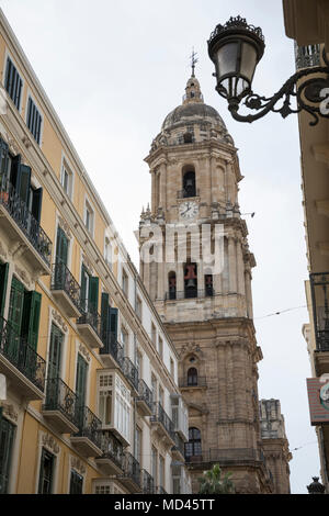 Tower of Catedral de la Encarnacion de Malaga between narrow streets of the old town, Malaga, Costa del Sol, Andalucia, Spain, Europe - Stock Photo