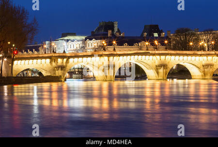 The Pont Neuf New Bridge and Seine river at night , Paris, France. - Stock Photo