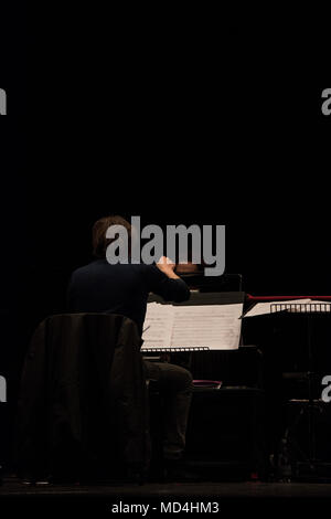 orchestra conductor on stage during reharsals - Stock Photo