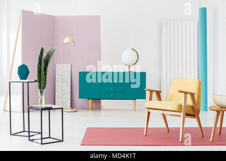 Inspiration for a designer living room interior color scheme with a modern, turquoise blue sideboard and industrial, marble counter tables - Stock Photo