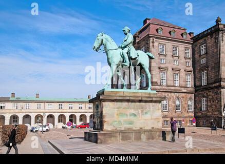 COPENHAGEN, DENMARK - APRIL 13, 2010: Equestrian statue of Christian IX near Christiansborg Palace (Christiansborg Slot) - Stock Photo