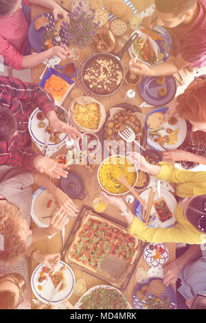 A variety of organic, vegetarian food on a table in a restaurant - Stock Photo