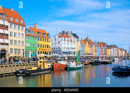 COPENHAGEN, DENMARK - APRIL 13, 2010: Colorful facades along Nyhavn. Nyhavn is a 17th-century waterfront, canal and entertainment district - Stock Photo
