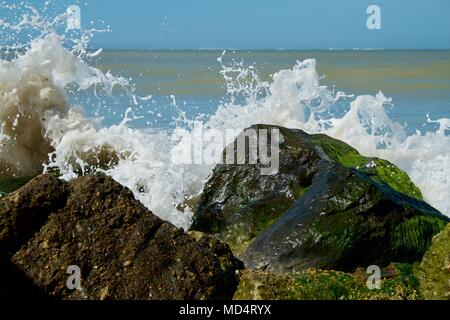 spume and wave on rocks at Colwell Bay, Isle of Wight, United Kingdom - Stock Photo