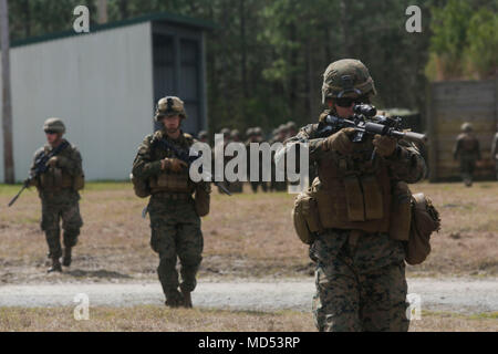 U.S. Marines from different units maneuver through the range during an urban breaching range at Camp Lejeune, N.C., March 20, 2018. Marines from both 2nd Combat Engineer Battalion and 3rd Battalion, 6th Marine Regiment, 2nd Marine Division conducted the training together to further improve proficiency in creating and using explosive breaching charges as well as improving unit cohesion. (U.S. Marine Corps photo by Lance Cpl. Leynard Kyle Plazo)