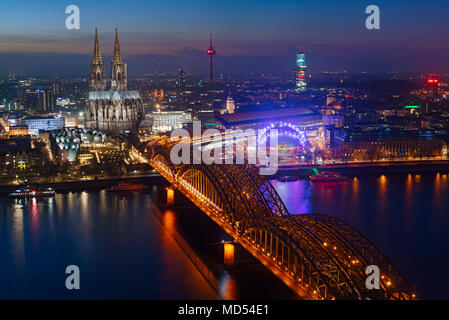 Cologne Cathedral and Hohenzollern Bridge in the last evening light, Cologne, North Rhine-Westphalia, Germany - Stock Photo