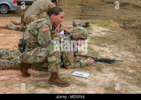 Fort Stewart, Ga., March 20, 2018 - Georgia Army National Guardsman Staff Sgt. Jennifer R. Heath-Strickland, operations noncommissioned officer, 170th Military Police Battalion, Decatur, Ga., coaches Spc. David Z. Keldie, military policaman, 179th Military Police Company, Fort Stewart, Ga., during the Georgia Army National Guard Small Arms Leaders Course.  The course teaches advanced marksmanship tactics and techinques so Soldiers so they can return to their units and teach their Soldiers.  (Georgia Army National Guard phot by Staff Sgt. R.J. Lannom Jr.)