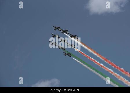 Pozzuoli, Italy. 18th Apr, 2018. Air show of the Frecce Tricolori, Italian National Acrobatic Patrol during the oath of the students of the Air Force Academy in Pozzuoli, province of Napoli. Credit: Paola Visone/Pacific Press/Alamy Live News - Stock Photo