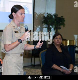 PANAMA CITY, Florida - Navy Experimental Diving Unit Research Psychologist Lt. Jenna Jewell, USN, answers questions during a 2018 Women's History Month panel session held March 13, 2018 in Panama City, Florida. The event, hosted by Naval Surface Warfare Center Panama City Division, featured leadership videos that focused on the importance of diversity, inclusion, and embracing change for recruiting and retention purposes. U.S. Navy photo by Eddie Green. - Stock Photo