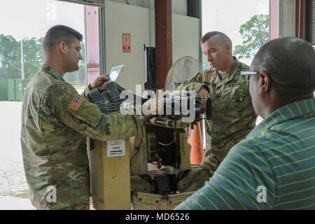 Fort Stewart, Ga., March 20, 2018 - Georgia Army National Guardsmen Staff Sgt. Christopher Robinson, Bravo Company, 3rd Battalion, 121st Infantry, Atlanta, Ga., and Sgt. Bradley Sherman, Charlie Company, 12nd Battalion, 12st Infantry , Cordele, Ga., perform pre-system checks on the CROWS weapon system to ensure porper operation.  The Common Remotely Operated Weapon Station is an externally mounted weapons control system that allows the gunner to remain inside the vehicle while firing various crew served Weapons.  (Georgia Army National Guard photo by Staff. Sgt. R.J. Lannom Jr.)