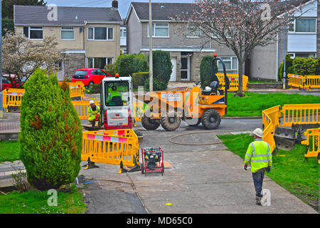 Workmen replacing old gas pipes in Rhiwbina, Cardiff. This involves digging up road and replacing equipment and pipework. - Stock Photo