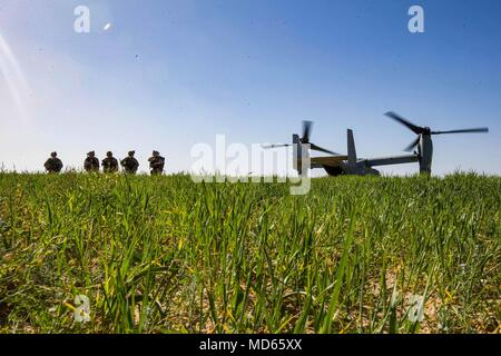HAIFA, Israel (March 14, 2018) U.S. Marines assigned to the Tactical Recovery of Aircraft Personnel (TRAP) team, 26th Marine Expeditionary Unit (MEU), arrive in a landing zone of an MV-22B Osprey aircraft to conduct a simulated search mission, in Haifa, Israel, March 14, 2018. Juniper Cobra is a computer assisted exercise conducted through computer simulations focused on improving combined missile defense capabilities and overall interoperability between the U.S. European Command and Israel Defense Force. (U.S. Marine Corps photo by Lance Cpl. Tojyea G. Matally/Released) - Stock Photo