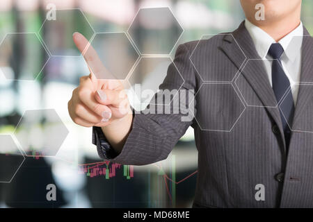 Businessman pressing virtual media type of buttons with stock graph. - Stock Photo
