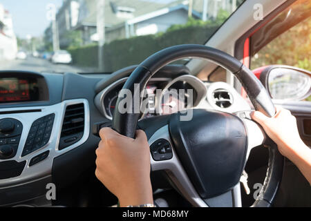 Cropped shot of  hands holding wheel with driving. - Stock Photo