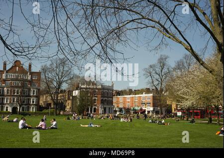 People having enjoying the summer sunshine on chiswick green 2018 - Stock Photo