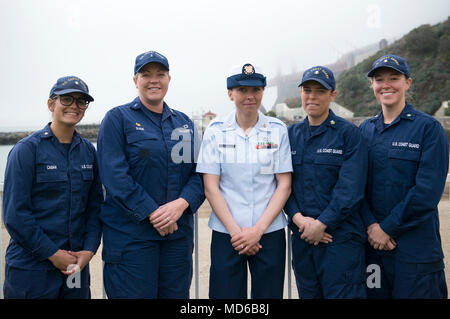 Coast Guard women assigned to Station Golden Gate in Sausalito, California, pose for a group photo after Petty Officer 1st Class Krystyna Duffy (center) received her surfman insignia during a ceremony at the station, March 9, 2018. Chief Warrant Officer Beth Slade (pictured 2nd from left), the station's commanding officer, was the first woman to qualify as a surfman on the 47-foot Motor Lifeboat, in 2002. (U.S. Coast Guard photo by Petty Officer 2nd Class Cory Mendenhall/released). - Stock Photo