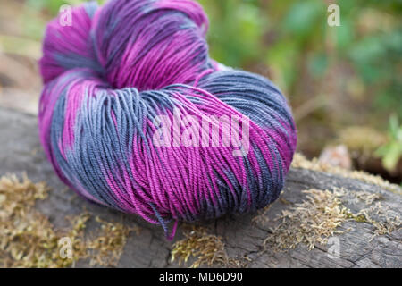 Colorful wool yarn on the rustic background - Stock Photo