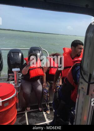 A family of four were rescued from the water by a Coast Guard Station Islamorada 33-foot Special Purpose Craft—Law Enforcement boatcrew Sunday, April 15, 2018 in Blackwater Sound near Key Largo. The boatcrew took the family to Gilberts Marina with no reported injuries. U.S. Coast Guard photo by Petty Officer 2nd Class Gabriel Kaczoroski - Stock Photo