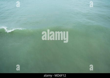 The surface of the ocean with cresting waves. - Stock Photo