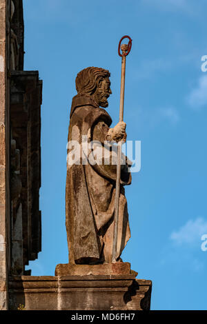 Statue of Santiago on the facade of the church of San Pedro in the village of Limpias, Cantabria, Spain - Stock Photo