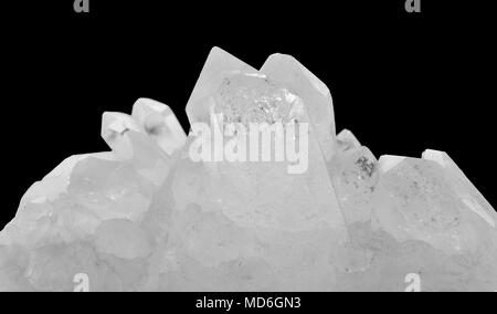 Close-up of a specimen of rock crystal on black background - Stock Photo
