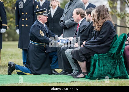 The American flag is presented to Guy Warden during the full honors repatriation of his uncle, U.S. Army Cpl. Dow F. Worden, in Section 60 of Arlington National Cemetery, Arlington, Virginia, March 27, 2018.    Worden, 20, from Boardman, Oregon, went unaccounted in late September 1951 during the Korean War. A member of Company A, 1st Battalion, 9th Infantry Regiment, 2nd Infantry Division, Worden's company was in the vicinity of Hill 1024 in South Korea, conducting operations near an area known as Heartbreak Ridge, when the Chinese launched an attack. The company repelled and was relieved by t - Stock Photo