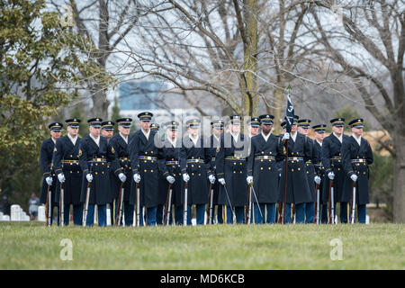 The U.S. Army Honor Guard assist in conducting the full honors repatriation of U.S. Army Cpl. Dow F. Worden in Section 60 of Arlington National Cemetery, Arlington, Virginia, March 27, 2018.    Worden, 20, from Boardman, Oregon, went unaccounted in late September 1951 during the Korean War. A member of Company A, 1st Battalion, 9th Infantry Regiment, 2nd Infantry Division, Worden's company was in the vicinity of Hill 1024 in South Korea, conducting operations near an area known as Heartbreak Ridge, when the Chinese launched an attack. The company repelled and was relieved by the Republic of Ko - Stock Photo