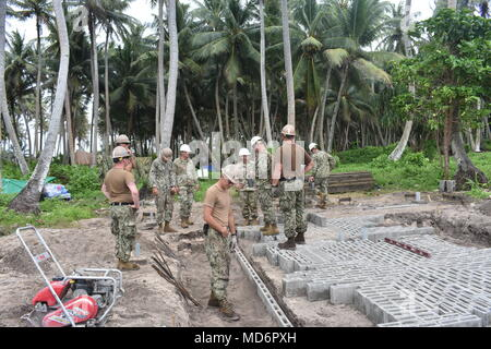 180320-N-DE561-0008 BIGEJ, Marshall Islands (March 20th 2018) Seabees assigned to Naval Mobile Construction Battalion (NMCB) 11, Construction Civic Action Detail Marshall Islands discuss project progress with leadership from the United States Army Garrison, Kwajalein Atoll. NMCB-11 is forward deployed to execute construction, humanitarian and foreign assistance, and theater security cooperation in the 7th Fleet area of operations. (U.S. Navy photo by Builder Constructionman Jessika Corwin) - Stock Photo