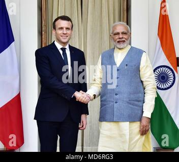 Indian Prime Minister Narendra Modi, right welcomes French President Emmanuel Macron, left, to Hyderabad House prior to bilateral meetings March 10, 2018 in New Delhi, India. - Stock Photo