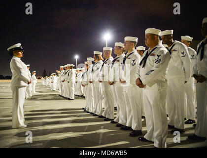 """180316-N-PN275-1007 SAN DIEGO (Mar. 16, 2018)  Sailors from Naval Medical Center San Diego""""s (NMCSD) Directorate for Administration (DFA) stand in formation during a dress whites inspection. DFA is committed to providing quality, timely, innovative and economical healthcare administration to staff and patients of NMCSD. (U.S. Navy Photo by Mass Communication Specialist 2nd Class Zachary Kreitzer) - Stock Photo"""