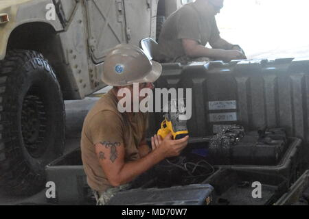 180329-N-MS236-0001 KWAJALEIN, Marshall Islands (March 29th 2018) Builder Constructionman Stephen Cheshire, assigned to Naval Mobile Construction Battalion (NMCB) 11, Construction Civic Action Detail Marshall Islands, conducts an inventory of the central tool room. NMCB-11 is forward deployed to execute construction, humanitarian and foreign assistance, and theater security cooperation in the 7th Fleet area of operations. (U.S. Navy photo by Construction Electrician 2nd Class Joshua Zapien) - Stock Photo