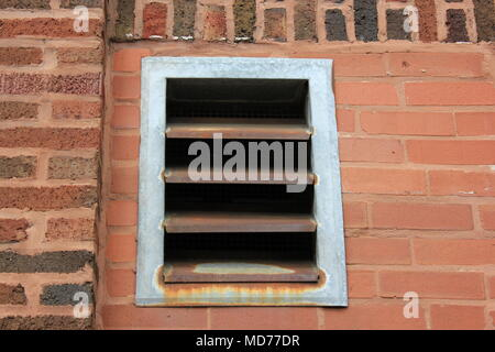 Alley view of an air duct exhaust vent of the Pickwick Theater. - Stock Photo