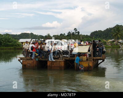 Red Cross Vehicle loaded on a raft to crossing over the water bay during Humanitarian Mission of Indian Ocean Earthquake and Tsunami in Aceh. - Stock Photo