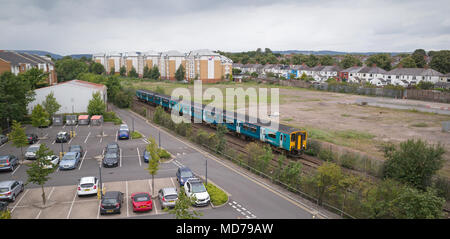 Twin Class 150 diesel train units on Arriva Trains Wales service to Cardiff Central passing car park of Cardiff University north of Cathays station - Stock Photo