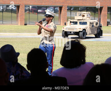Sgt. Maj. Stephanie K. Murphy, former sergeant major, Marine Corps Logistics Command, addresses family members, Marines and civilian-Marines during a retirement ceremony held aboard Marine Corps Logistics Base Albany, Ga., March 22. - Stock Photo