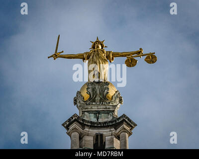 Bronze statue of Lady Justice, executed by the British sculptor F. W. Pomeroy. A sword in her right hand and the scales of justice in her left hand. - Stock Photo