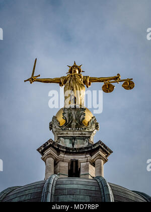 Bronze statue of Lady Justice, executed by the British sculptor F. W. Pomeroy. She holds a sword in her right hand and the scales of justice in her le - Stock Photo