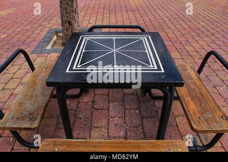 Board games on the street on wooden table and chairs - Stock Photo