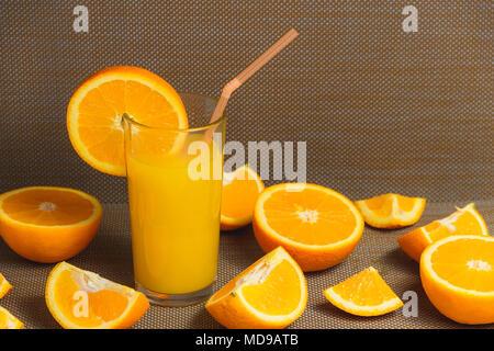 Sliced Orange and Juice Drink on Dark Background. Healthy Concept. - Stock Photo