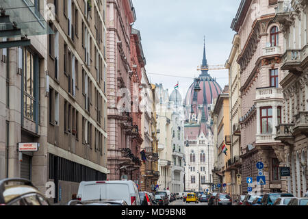BUDAPEST, HUNGARY - APRIL 7, 2018: Hungarian Parliament (orszaghaz) seen from a nearby street.  It is one of the main touristic landmarks of the city  - Stock Photo