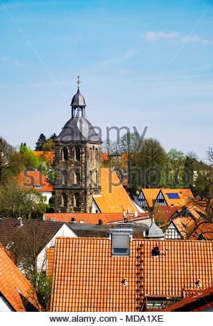 Die evangelisch Stadtkirche — the Protestant town church — of Tecklenburg with its surrounding neighborhood of red tile roofs - Stock Photo