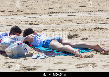 Bournemouth, Dorset, UK. 19th April 2018. UK weather: lovely warm sunny day at Bournemouth beaches with clear blue skies and unbroken sunshine, as visitors head to the seaside to enjoy the warmest day of the year so far. Credit: Carolyn Jenkins/Alamy Live News - Stock Photo