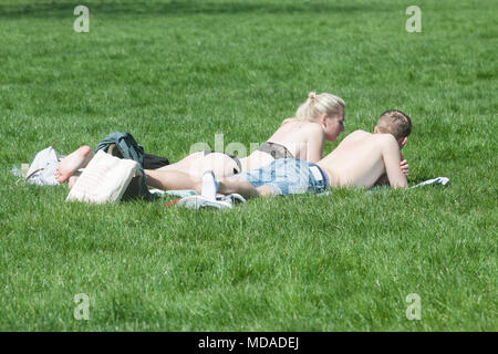 London UK. 19th April 2018. Sun worshippers sunbathe in Green Park  on a hot sunny spring day. Today has been the hottest day the year since  Credit: amer ghazzal/Alamy Live News - Stock Photo