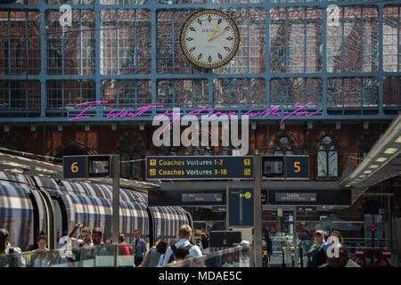 London, UK. 19th April 2018. The new neon artwork by Tracey Emin hangs over the international station at St Pancras - the message for lovers is 'I want my time with you'.Credit: Guy Bell/Alamy Live News - Stock Photo