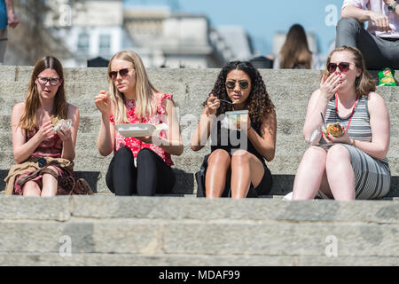 London, UK. 19th April, 2018. UK Weather: April Sunshine. Londoners enjoy the hottest day of the year so far in the city centre with temperatures reaching nearly 28C. Credit: Guy Corbishley/Alamy Live News - Stock Photo